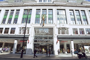 Next outperforms expectations in Q1